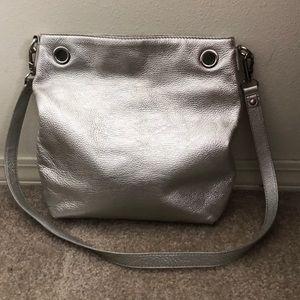 Michael Kors silver leather purse w/large grommets